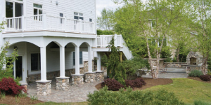 Arched stone columns create a two-story deck